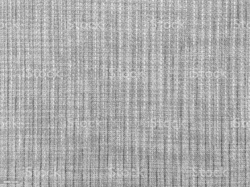 Closeup surface abstract fabric pattern at the brown fabric carpet at the floor of house texture background in black and white tone stock photo