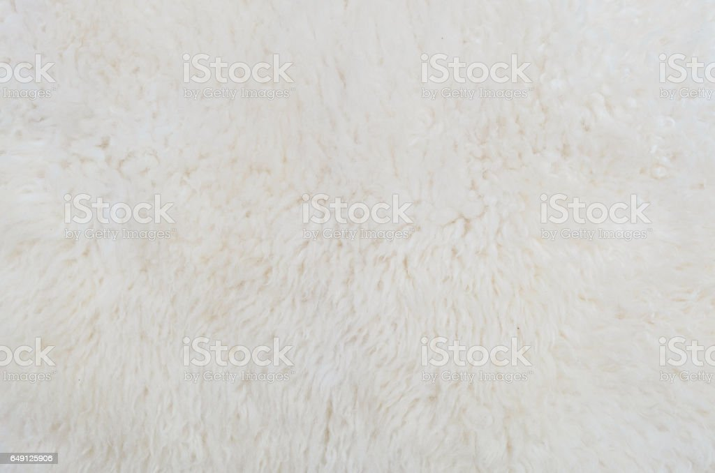 Closeup surface abstract fabric pattern at the white fabric carpet made from wool at the floor of house texture background stock photo