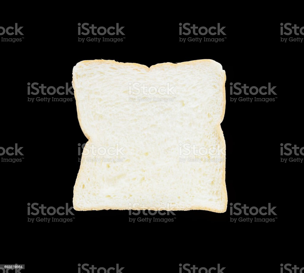 Closeup surface slice bread for breakfast with shadow isolated on black background stock photo