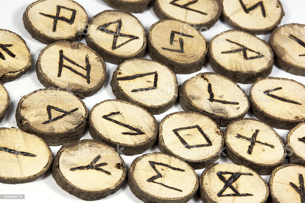 Closeup Symbols on Collection of Wooden Runes stock photo