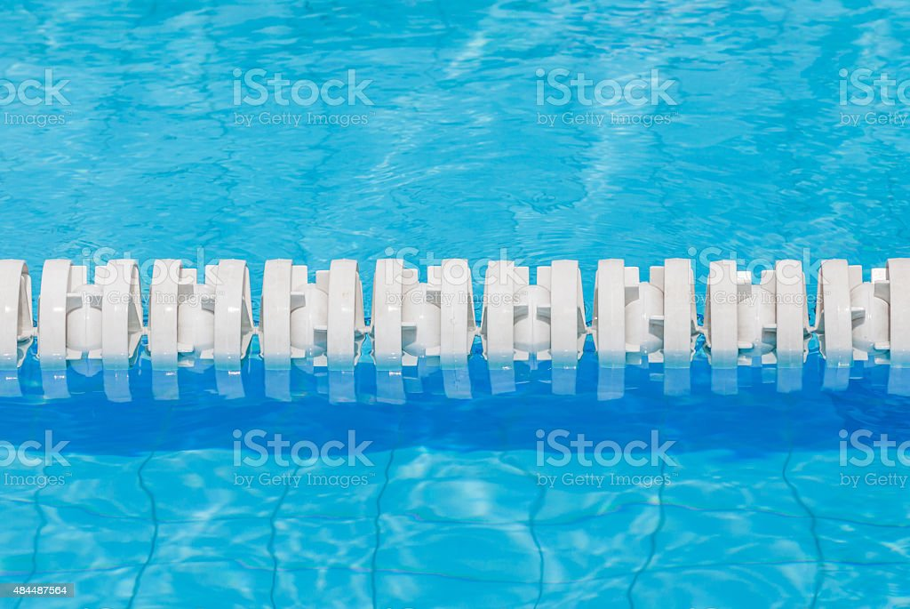 Closeup the white marked lanes in swimming pool for competitions. stock photo