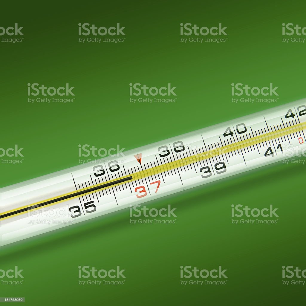close-up thermometer on green background royalty-free stock photo