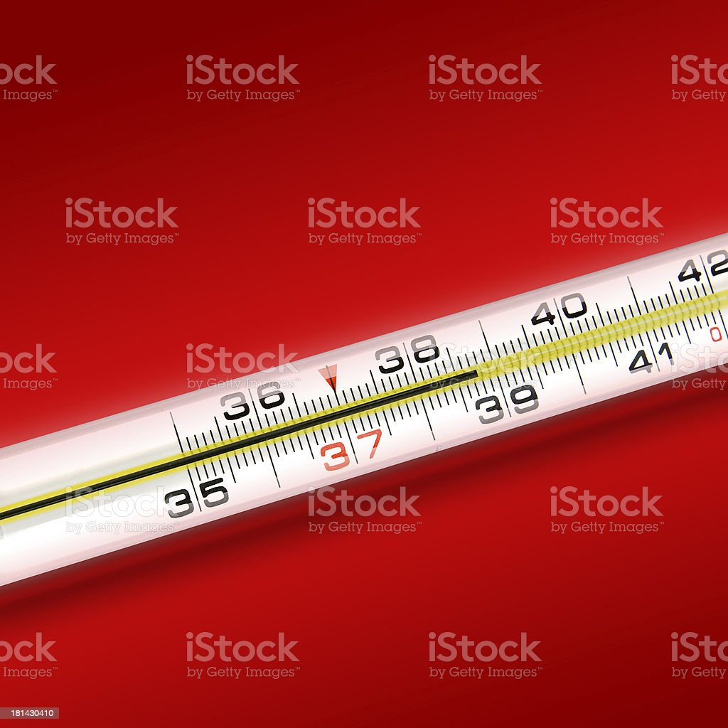 close-up thermometer on red background royalty-free stock photo