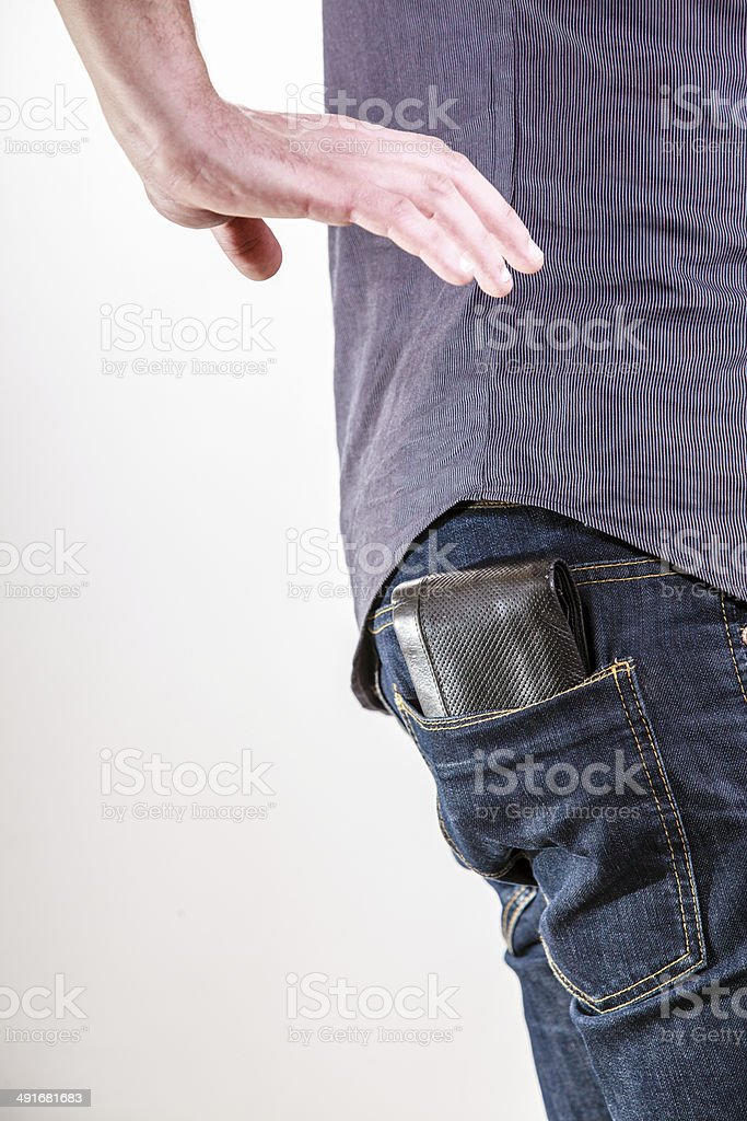Closeup. Thief stealing wallet from back pocket of man. Theft. stock photo