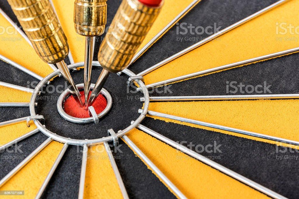 Closeup three dart target on bullseye stock photo