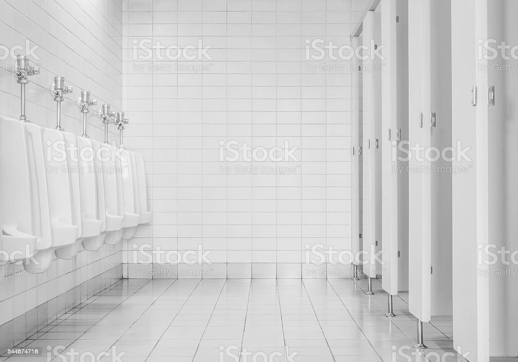 Closeup tiles wall in the toilet of man background stock photo