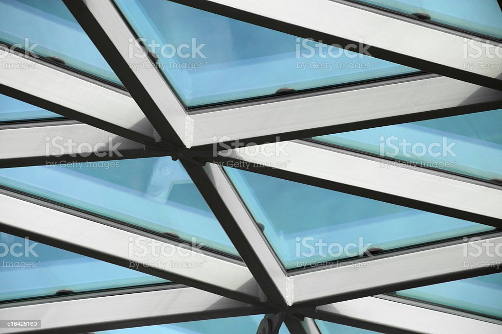 Close-up tilt photo of contemporary structural glass roof fragment stock photo