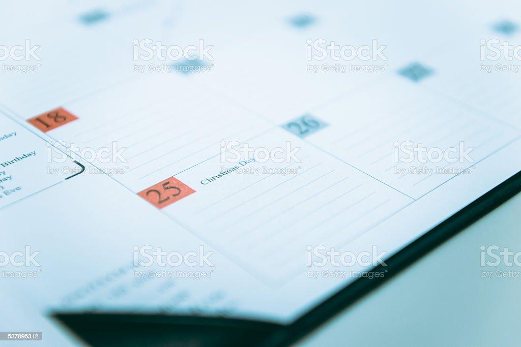 Closeup to December 25 on a calendar Schedule stock photo