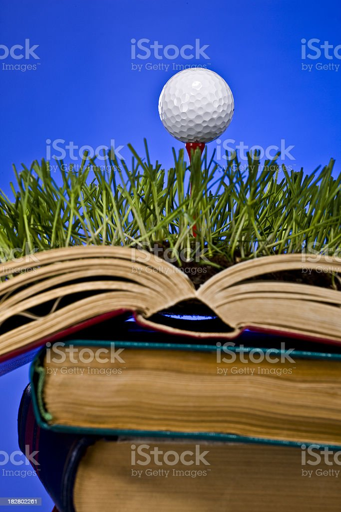 Close-up to Golf Knowledge Book on Blue royalty-free stock photo