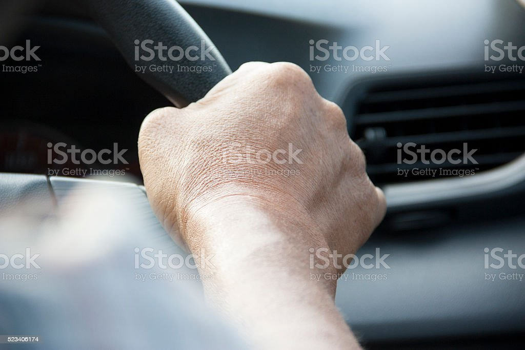 Closeup to hand elderly and have wringle person drive car stock photo