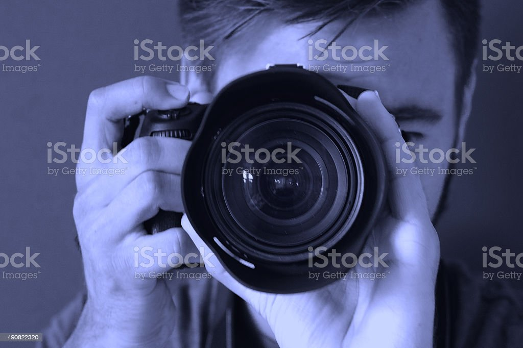 Close-Up To Photographer With Purple filter stock photo