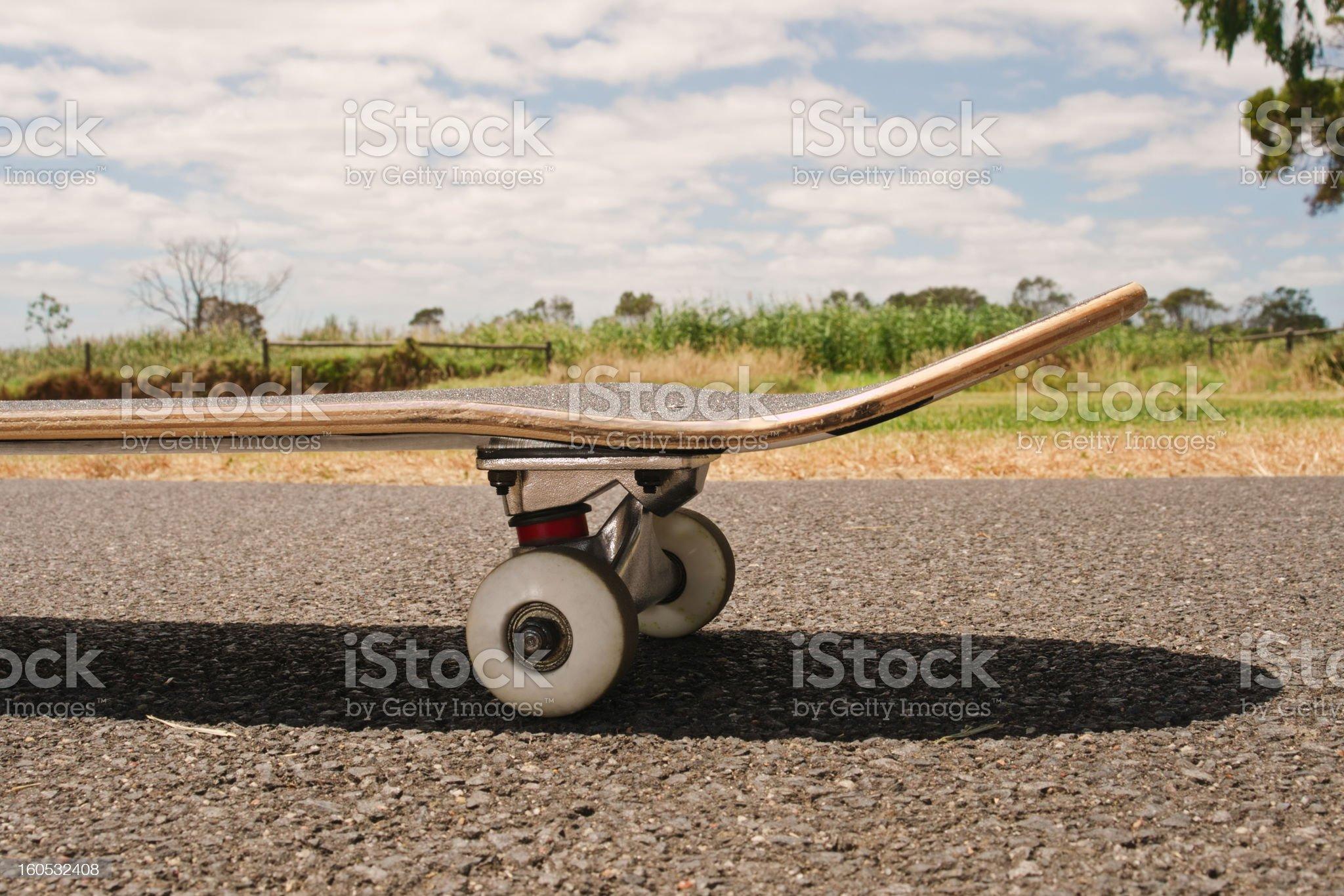 Closeup to skateboard of asphalt royalty-free stock photo
