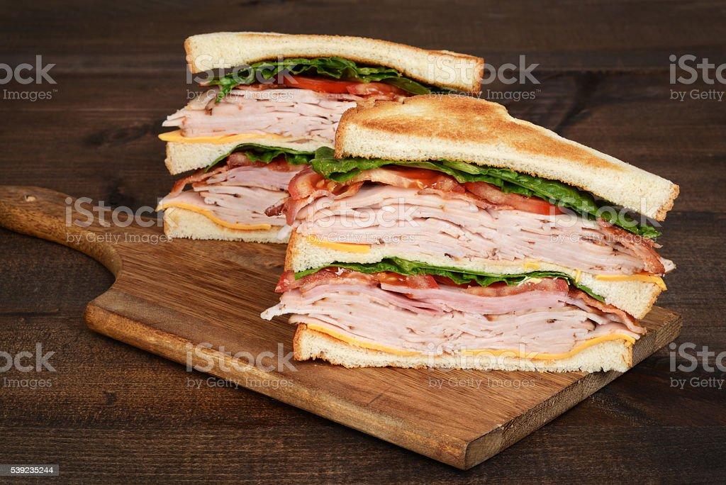 closeup toasted chicken club sandwich stock photo
