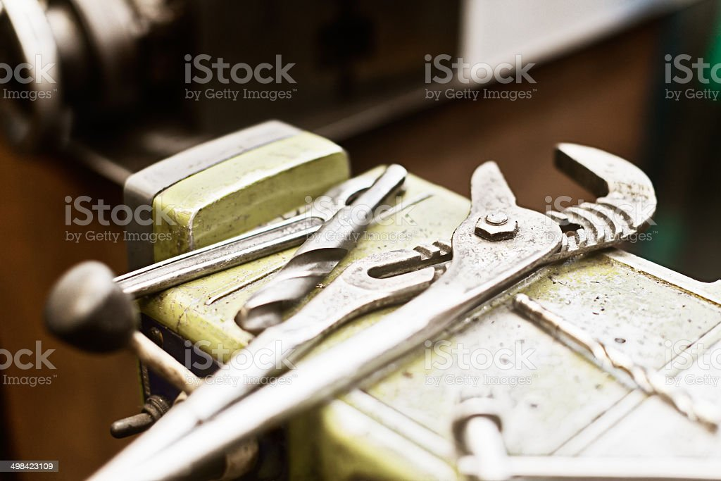 Close-up tools sitting on a vise grip in a factory royalty-free stock photo