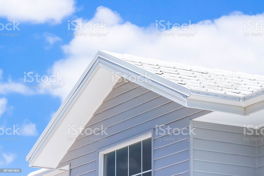 Closeup top view of new house against sky, copy space stock photo