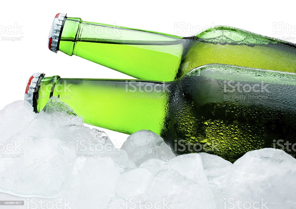 Close-up Two green bottles of beer cool in ice royalty-free stock photo