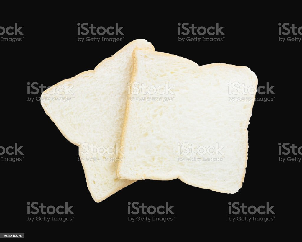 Closeup two slice bread for breakfast with shadow isolated on black background stock photo