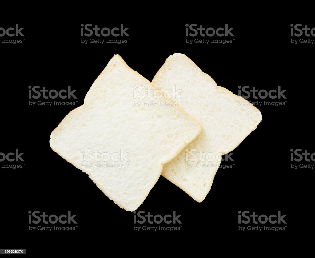 Closeup two slice bread for breakfast with shadow isolated on black background with clipping path stock photo