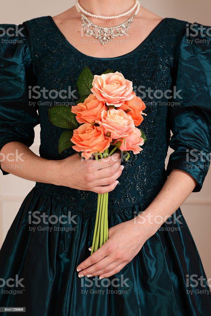 closeup victorian woman holding roses stock photo