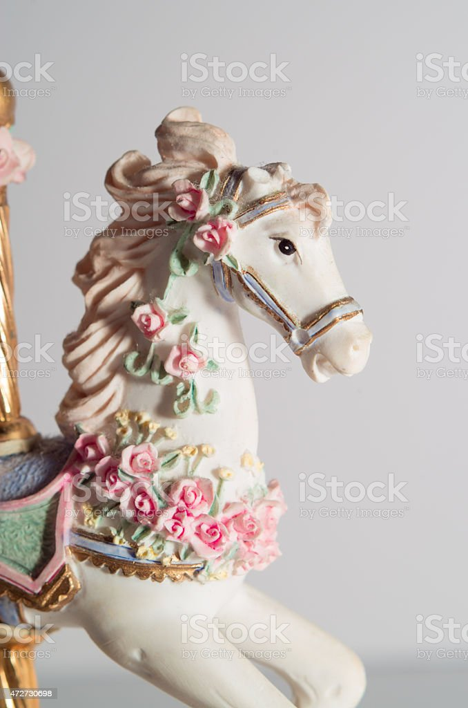 Closeup view carousel horse decoration on white background stock photo