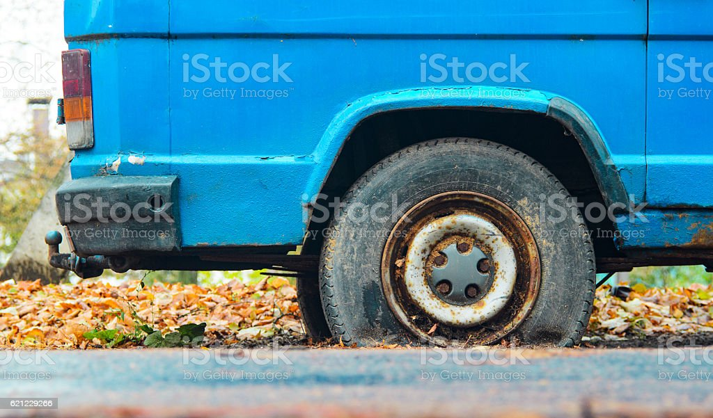 Close-up view flat rear tire on a car stock photo