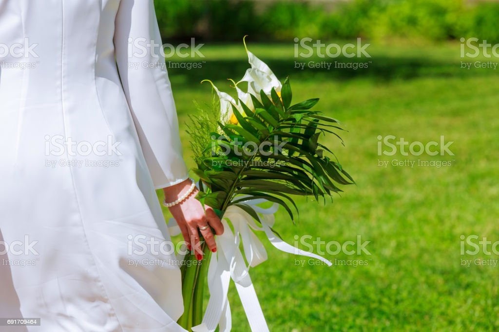 Close-up view of a bride holding a bouquet white flowers stock photo