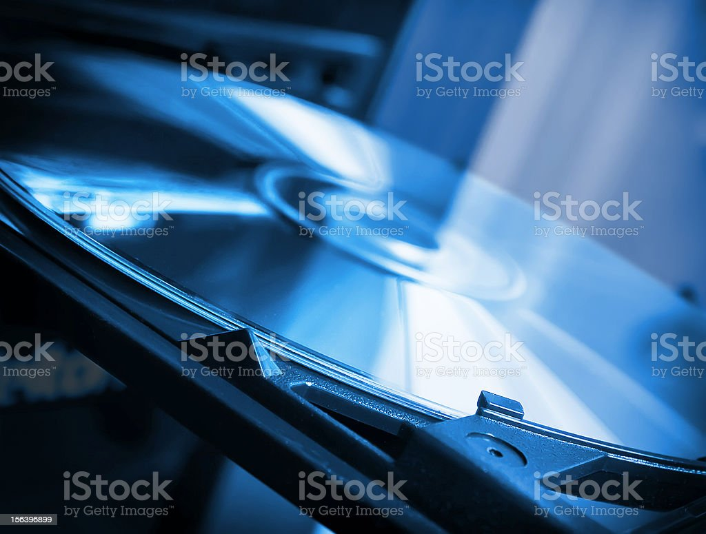 Close-up view of a CD or DVD in a player stock photo