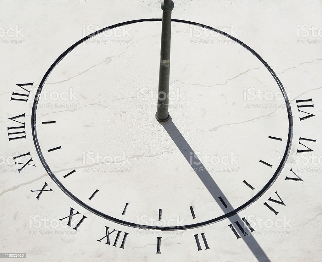 Closeup view of a clean and minimalistic sun dial stock photo