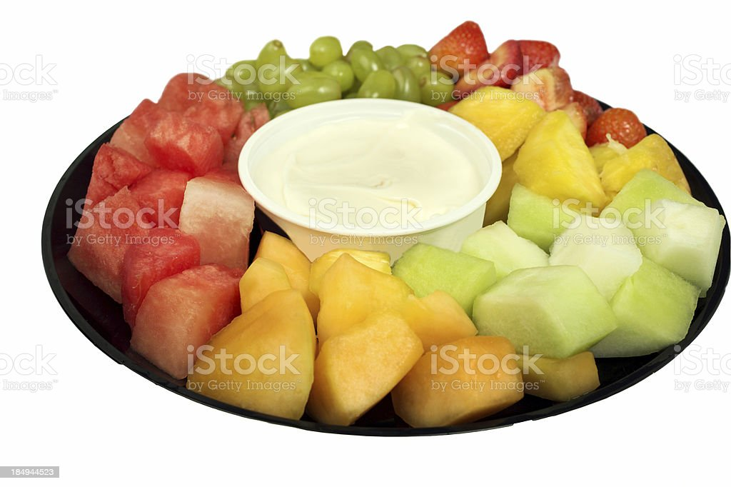 A close-up view of a fresh fruit salad with a creamy dip stock photo