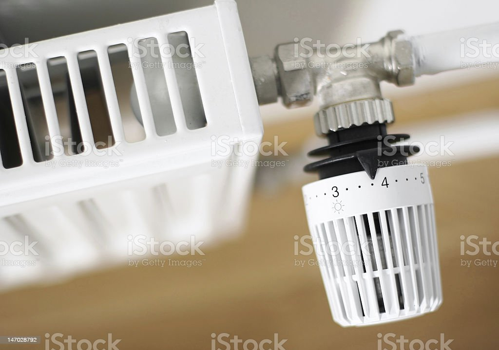 Close-up view of a household radiator valve and dial stock photo
