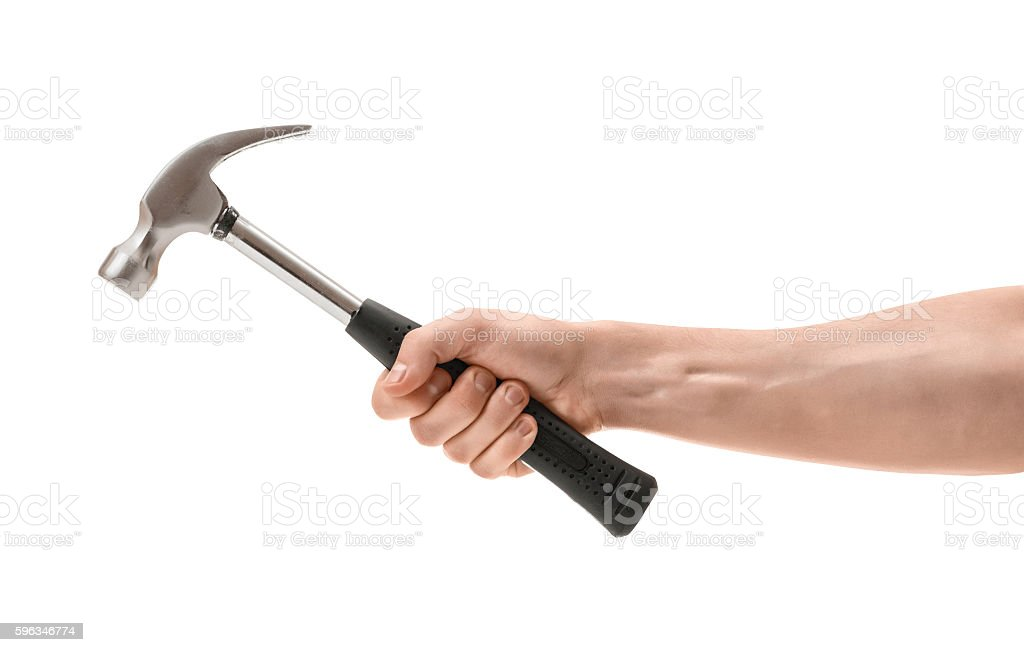 Close-up view of a man's hand holding hammer stock photo