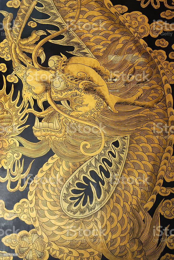 Close-up view of a mural depicting a golden Chinese dragon stock photo