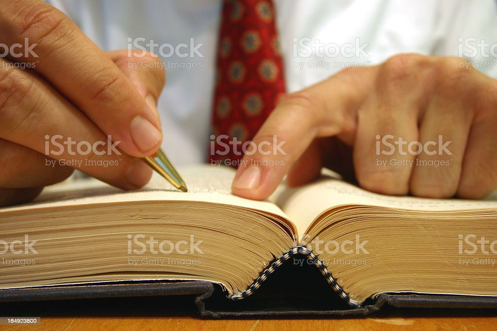 Close-up view of a person highlighting a hardcover book royalty-free stock photo