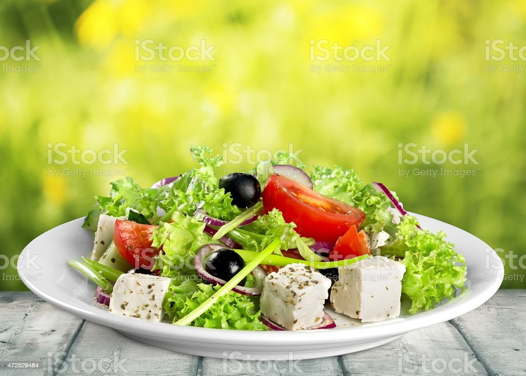 Closeup view of a plate of fresh healthy Greek salad stock photo
