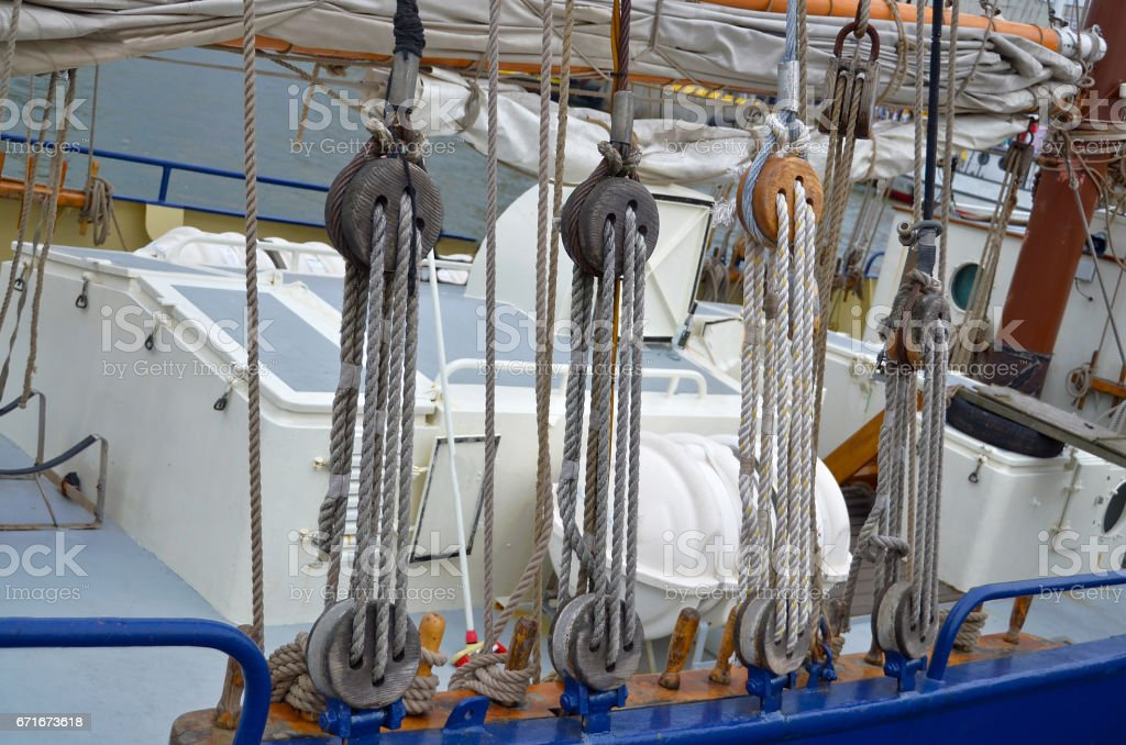Closeup view of a rope pulley or tackle on a sailboat stock photo