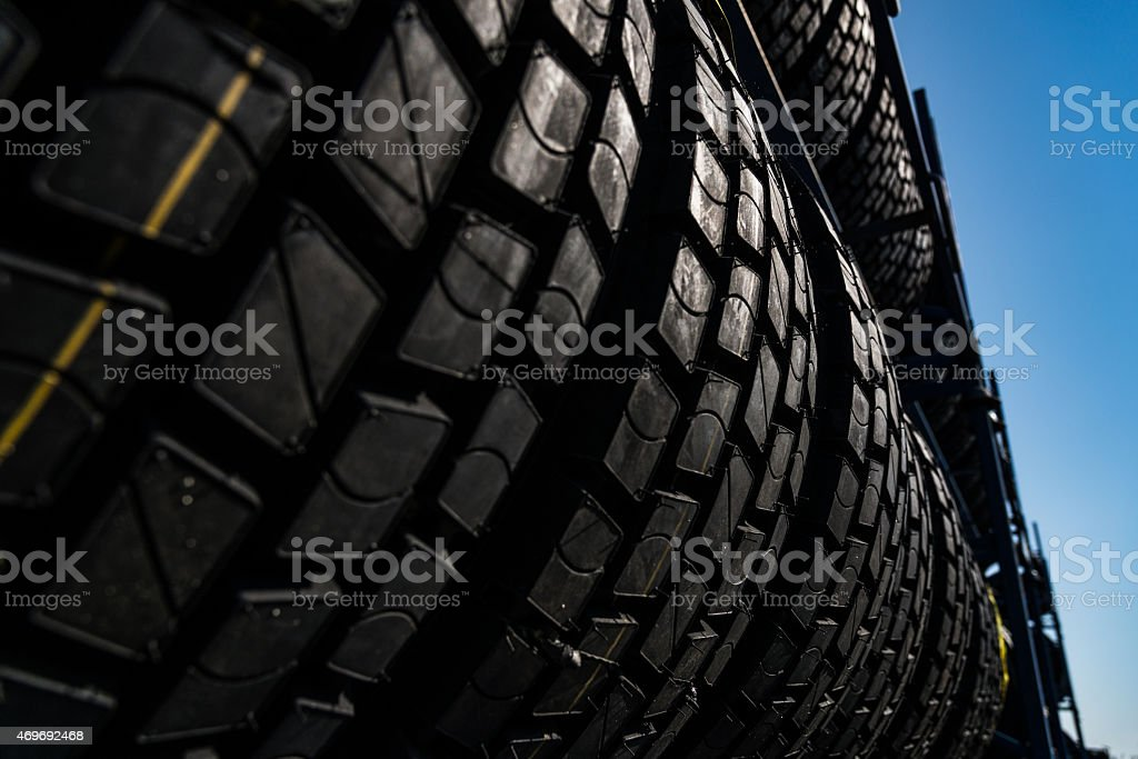 Closeup view of a row of brand new car tires stock photo