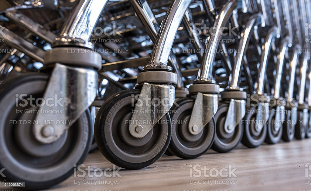 Close-up View of a Row of Stacked Supermarket Trolleys stock photo