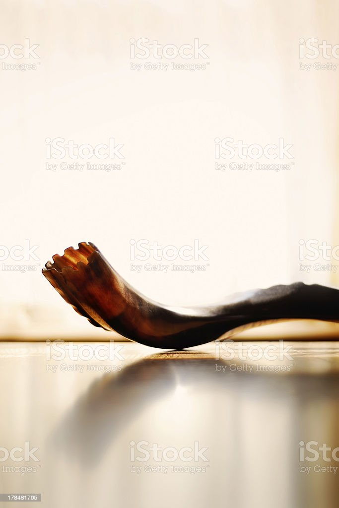 A close-up view of a shofar on a reflective surface stock photo