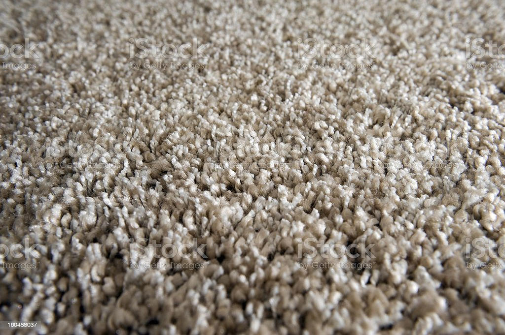 A close-up view of a tan carpet royalty-free stock photo