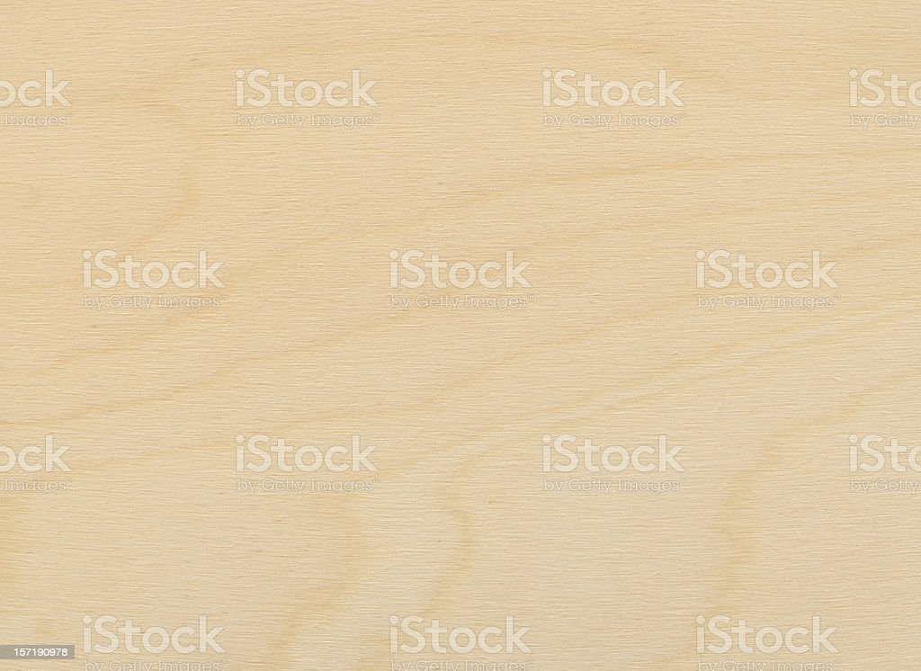 Close-up view of a uniformly lit birch plywood board stock photo