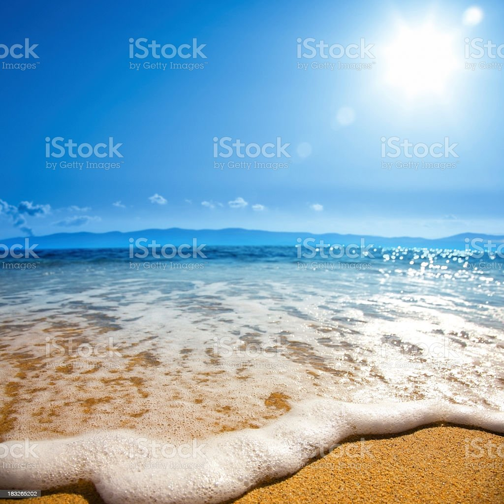 Closeup view of a wave on the beach stock photo