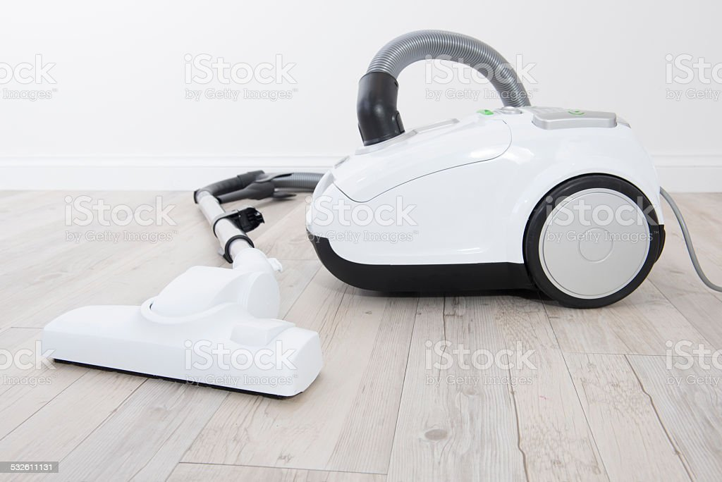 Closeup view of a white vacuum cleaner. stock photo