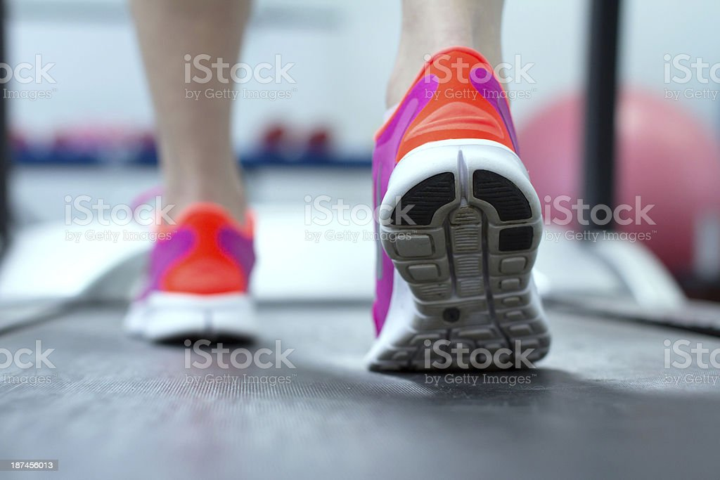 Close-up view of a woman wearing purple and red sneakers stock photo