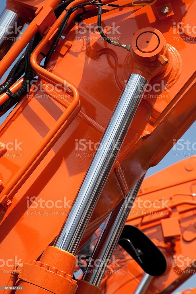 Closeup view of an orange hydraulic system stock photo