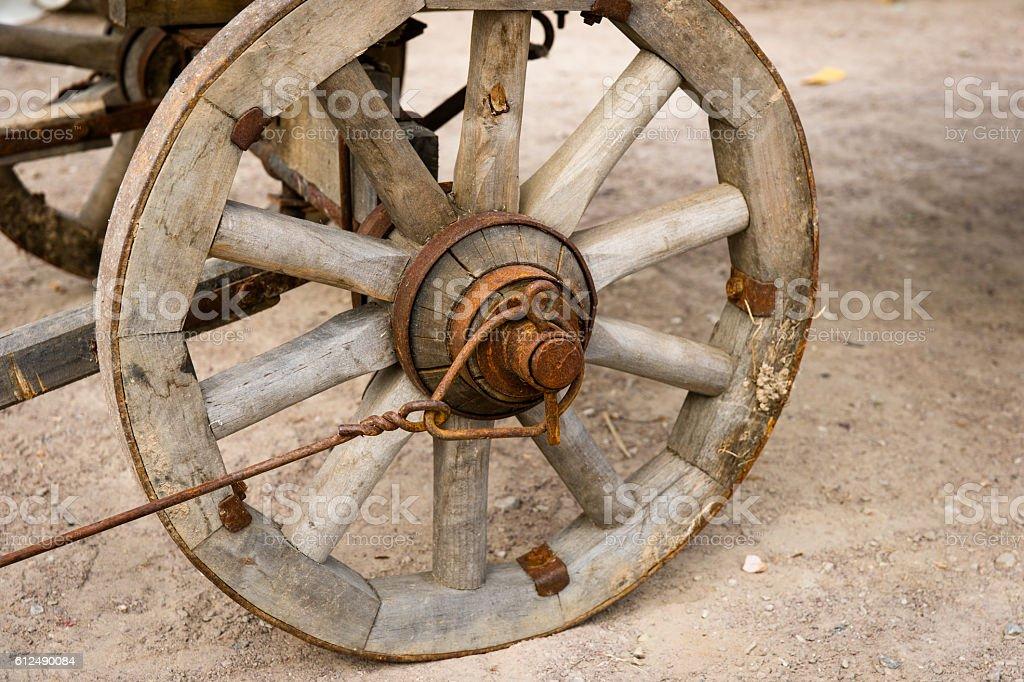Closeup view of an vintage wooden cart-wheel stock photo