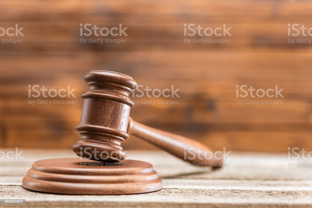 Close-up view of brown wooden mallet of judge on wooden table, law concept stock photo
