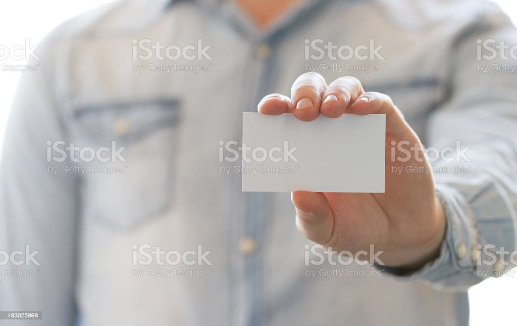 Close-up view of businessman hand showing empty business card stock photo