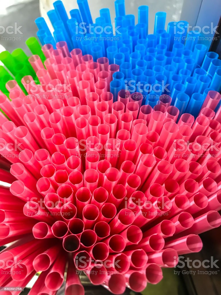 Closeup view of Colorful plastic straws in street food market stall stock photo