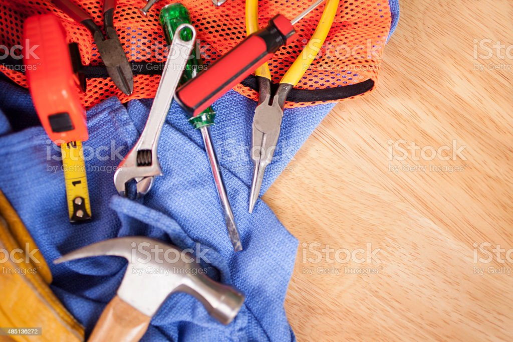 Close-up view of construction worker's supplies. Hammer, tools. stock photo
