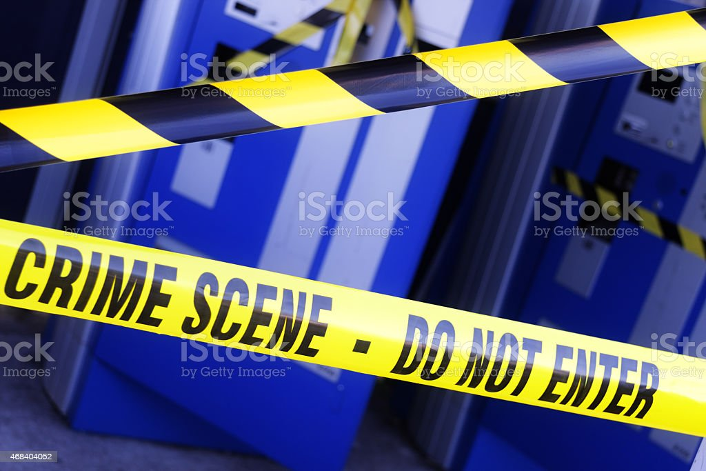 Close-up view of crime scene tape blocking an entrance stock photo